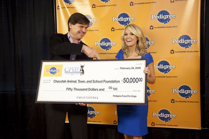 Carrie Accepts Check from Pedigree