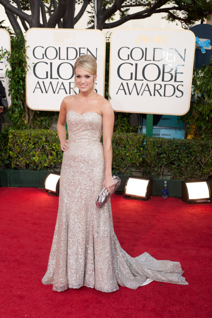 "Nominated for BEST ORIGINAL SONG MOTION PICTURE for ""There's A Place For Us"" for Chronicles Of Narnia: The Voyage Of The Dawn Treader, Carrie Underwood attends the 68th Annual Golden Globe Awards at the Beverly Hilton in Beverly Hills, CA on Sunday, January 16, 2011. ++ FASHION TAGS ++ Carrie Underwood: Badgley Mischka"